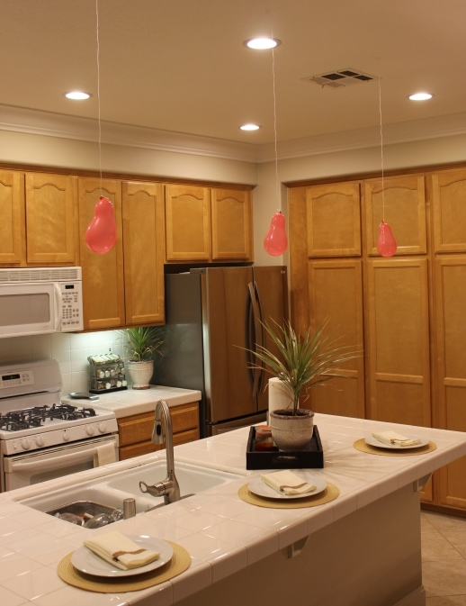 Picture of using balloons to visualize pendants lighting in a kitchen