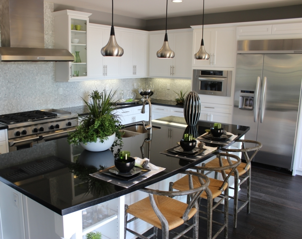 Image of kitchen pendant lighting over three place settings