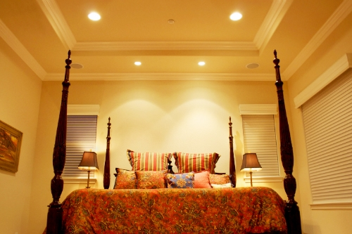 General and task recessed lighting in a bedroom